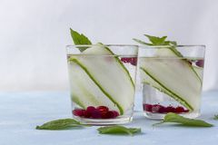 Fresh cool detox drink with cucumber and berries, lemonade in a glass with a mint royalty free stock images