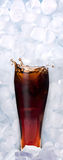 Fresh cool glass of cola in ice cube Royalty Free Stock Image