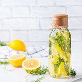 Fresh cool lemon thyme infused water detox drink. Health care, fitness, healthy nutrition diet concept. Fresh cool lemon thyme infused water, cocktail, detox stock images
