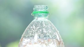 Fresh cool mineral water. Bottle of fresh mineral water fullHD video. Close-up of plastic bottle cool soda water on abstract light background stock video