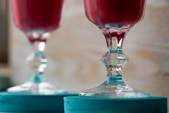 Fresh cool smoothie in a glass with a stem. Delicious and healthy Breakfast.Of cherries and strawberries. Fresh cool smoothie in a glass with a stem. Delicious Stock Image