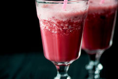 Fresh cool smoothie in a glass with a stem. Delicious and healthy Breakfast.Of cherries and strawberries. Fresh cool smoothie in a glass with a stem. Delicious Stock Photos