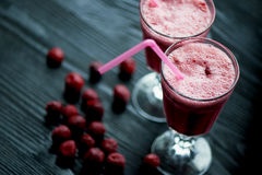 Fresh cool smoothie in a glass with a stem. Delicious and healthy Breakfast.Of cherries and strawberries. Fresh cool smoothie in a glass with a stem. Delicious Royalty Free Stock Image