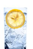 Fresh cool water with ice and lemon. Glass of fresh cool transparent water with ice and lemon Royalty Free Stock Photos