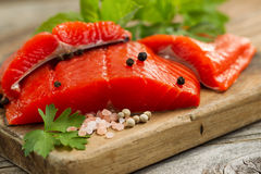 Fresh Copper River Salmon fillets on rustic wooden server with s Royalty Free Stock Photos