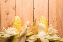 Fresh corn on cob on rustic wooden table, closeup. Ear of corn royalty free stock image
