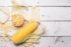 Fresh corn on cob on rustic wooden table, closeup. Ear of corn top view royalty free stock photos