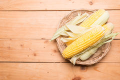Fresh corn on cob on rustic wooden table, closeup. Ear of corn top view stock photos