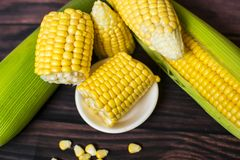 Fresh corn on cobs on wooden table, closeup, top view. Fresh corn on cobs on wooden table, closeup, top view Stock Image