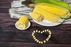 Fresh corn on cobs on wooden table, closeup, top view. Fresh corn on cobs on wooden table, closeup, top view Royalty Free Stock Photo