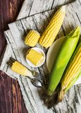 Fresh corn on cobs on wooden table, closeup, top view. Fresh corn on cobs on wooden table, closeup, top view Stock Photography