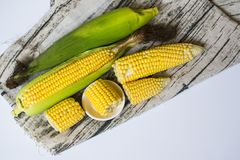 Fresh corn on cobs on wooden table, closeup, top view. Fresh corn on cobs on wooden table, closeup, top view Royalty Free Stock Photos