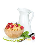 Fresh corn flakes with berries and milk jug. Isolated on white background Stock Photo