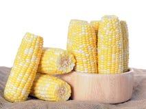 Fresh corn. A lot of fresh corn on the table Stock Photo