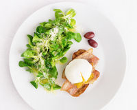 Fresh corn salad and poached egg on toast with fried bacon Stock Photos