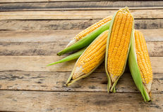 Fresh corn on wooden table background Stock Photography