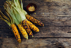 Fresh corn on wooden table Stock Photos