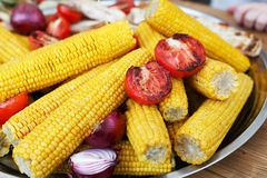 Fresh corncobs cooked at barbecue grill Royalty Free Stock Photo