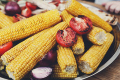Fresh corncobs cooked at barbecue grill Stock Photo
