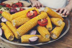 Fresh corncobs cooked at barbecue grill Stock Images