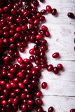 Fresh cornel berries on wooden table Royalty Free Stock Photo