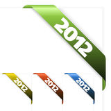 Fresh corner ribbon on a white paper with 2012 Stock Photography