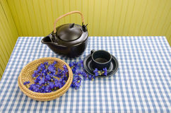 Fresh cornflower on wicker basket for vitality tea Royalty Free Stock Photo
