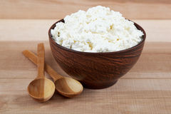 Fresh cottage cheese in a bowl with spoon Royalty Free Stock Photography