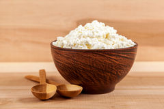Fresh cottage cheese in a bowl with spoon. Stock Image