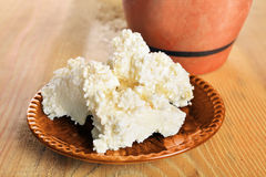 Fresh cottage cheese in ceramic bowl wooden board. Fresh cottage cheese in a ceramic bowl on a wooden board Royalty Free Stock Photography