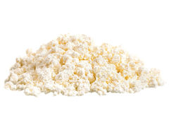 Fresh cottage cheese (curd) heap, isolated on white background . Stock Photos
