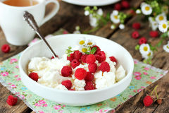 Fresh cottage cheese with juicy berries raspberries, dietary bre Royalty Free Stock Photography
