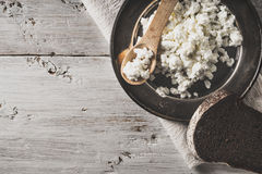 Fresh cottage cheese on the  metal plate  with bread on the white wooden table horizontal Stock Images