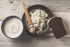Fresh cottage cheese on the  metal plate  with bread on the white wooden table top view Stock Images