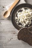 Fresh cottage cheese on the  metal plate  with bread on the white wooden table vertical Royalty Free Stock Photography