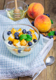 Fresh cottage cheese with peach, blueberry, almonds and honey Stock Photography