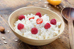 Fresh cottage cheese with raspberries Royalty Free Stock Photo