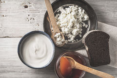 Fresh cottage cheese with sour cream, jam and bread on the white wooden table top view Stock Photo
