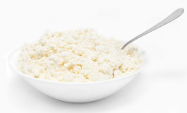 Fresh cottage cheese with spoon  Stock Images