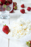 Fresh cottage cheese and strawberries on the table Royalty Free Stock Photo