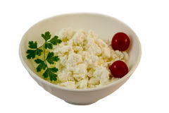 Fresh cottage cheese in white bowl. With tomatoes and parsley Stock Photos