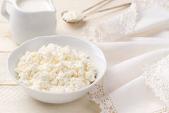 Fresh cottage cheese on a white wooden table (closeup) Stock Images