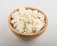 Fresh cottage cheese in wooden bowl Royalty Free Stock Photography