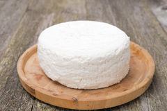 Fresh cottage cheese on a wooden plate Stock Photo
