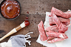 Fresh Country Ribs and Barbecue Sauce Stock Images