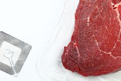 Meat with rfid tag scene. The fresh cow beef in food grade transparent packaging and rfid tag represent the food raw material and meat concept related idea Royalty Free Stock Images