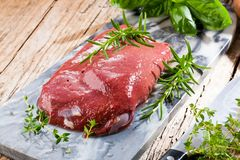 Fresh cow liver on grey marmor plate on a wooden background stock image