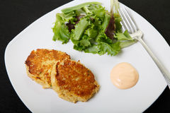 Crab Cakes with Salad and Sauce Stock Photos