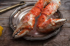Fresh crab claws on vintage wooden background. Composition with copy space Stock Images