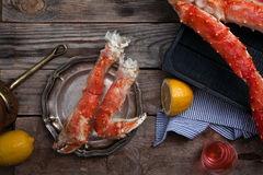 Fresh crab claws on vintage wooden background. With lemon slices. Composition with copy space Royalty Free Stock Photo